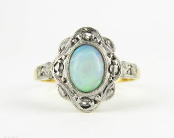 Antique Opal & Diamond Ring, Oval Cabochon Cut Opal with Diamond Halo. Circa 1910s, 18ct Gold and Platinum.
