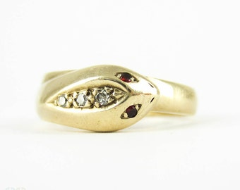 Vintage Snake Ring, 9 Carat Yellow Gold with Diamond Head & Garnet Eyes. Circa Mid 20th Century.