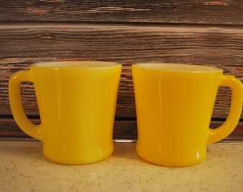 One Pair of HTF Fire King Sunshine Yellow D-Handle Coffee Mugs, Excellent Condition.