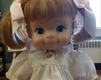 1974 HORSEMAN DOLL 12 INCHES . stand included in purchase,pig tails,pink bows blond hair blue eyes