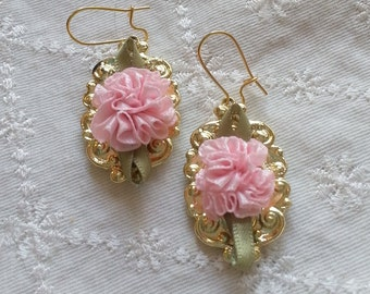 Pink rosettes on gold filigree earrings