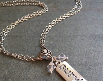 Survivor Pendant Necklace with a Silver Plated Chain by VZuniga Designs