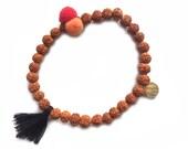 Bali Rudraksha bracelet with dark brown tassel and tubels