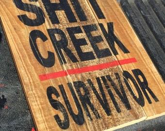 Funny sign Shit Creek survivor sign divorce humor cancer survivor rustic man cave sign funny office sign promotion gift paddle black red