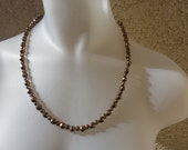 Warm, glowing bronze necklace