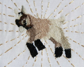 Dancing goat (hand-embroidered and framed)
