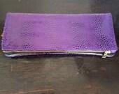 Purple leather snake print clutch