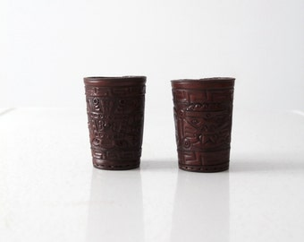pair Mexican leather cup holders cozies, vintage tooled leather dice cup thrower
