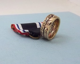 This is a POW Prisoner of War Service medal turned into a size 10 1/2  ring. Wear this on your special occasions.