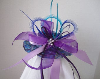 Fancy Purple with feathres hat Feathers By Nina's Couture Closet