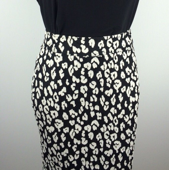 Pull-on style. Slim-fitting pencil skirt. All over leopard print. Knee-length. Zipper closure up the back. Small center slit on the back bottom hem. Smooth to the touch fabrication. Can be worn as a two-piece set with matching jacket. Model is wearing a plus size 28 in. 97% polyester. 3% spandex. Machine wash cold gentle cycle with like colors.