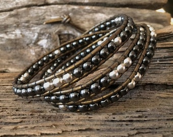 3 Wrap Leather Bead Bracelet made with 4mm Hematite and Tibetan Silver Beads on Black Leather.