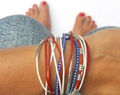 all American bracelet in red, white, and blue accented with silver beads. lobster clasp. Double wrap. Summer Olympics fashion.