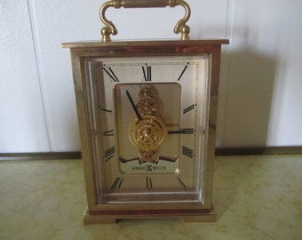 Howard Miller Gold Brass Desk Clock Battery Operated Skeleton Movement