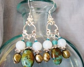 Turquoise teardrop dangle earrings with silver and white opal