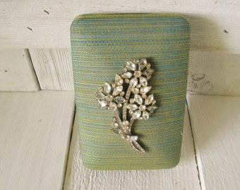 Vintage jewelry box green fabric clamshell rhinestone floral brooch embellished 1950s