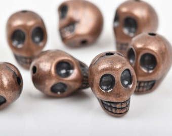 5 Copper Metal SKULL Beads, drilled top to bottom, 18mm, bme0397