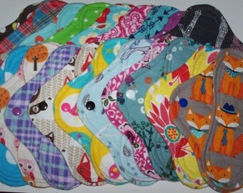 Set of 10 and set of 6  panty liners with wings 8 inches in random prints