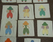 Quilt blocks:  Overall Sam hand embroidered and embellished 1940's cotton prints  11 blocks