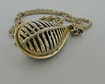 """1960's Heavy Gold Tone Hollow Pendant and 24"""" Gold Tone Chain."""
