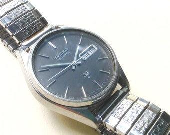Seiko SQ mens vintage watch Wrist watch Seiko Vintage mens silver toned stainless steel vintage watch dress wrist watch