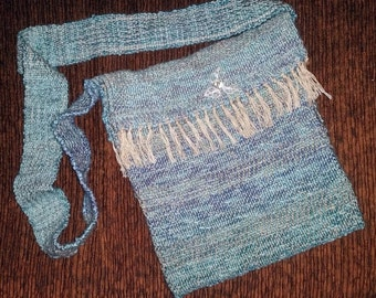 Handwoven seaside messenger bag with fringe
