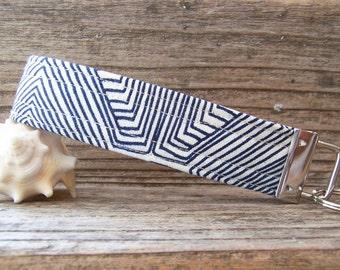 Blue and white geometric fabric key fob  , key ring in a fun fabric , key fob , key ring , wrist strap for keys or bag, navy blue key fob.