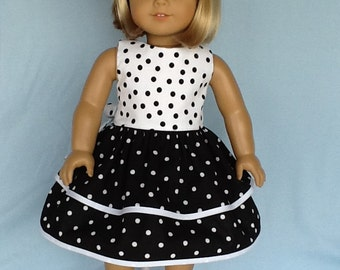 18 inch doll dress and hair clip.  Fits American Girl Dolls. Black and white dots.