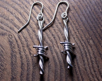 Barbed wire dangles in sterling silver
