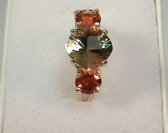 Oregon Sunstone Ring Green with red sunstone accents. #41