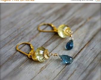 Lemon quartz & london blue topaz earrings. Gold lemon quartz earrings with blue topaz briolette. Mixed gemstone blue and yellow earrings.