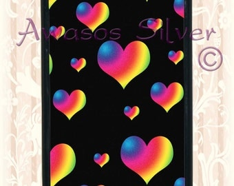 Beautiful black with rainbow hearts iPhone 5c or 5s case. Black or white rubber base