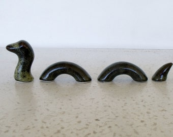 Loch Ness Figurine 4 Piece Ceramic Mythical Serpent Nessie