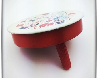 1950s metal round noise maker toy