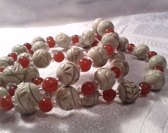Art Deco Egyptian Revival Necklace of Carved Bakelite/Casein Beads.