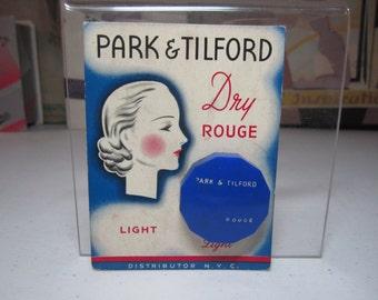 Art deco 1930's-40's Park & Tilford  unused color light blue plastic rouge container on Art Deco lady illustrated original card