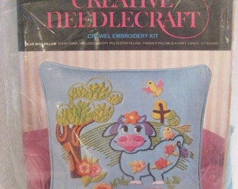 """Avon Crewel Embroidery """"Blue Moo"""" Cow Decorator Pillow Kit Vintage 1970s 12"""" Square Pillow"""