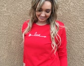 Valentine's Day Women's LOVE Shirt. Embroidered arrow with scripted love design.
