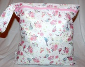 "Large wet bag in birds and flowers print. Multiple uses. Good quality for a good price. Measures 14""x16"""