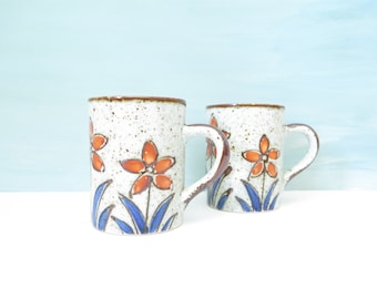 Set of 2 Vintage Speckled Stoneware Mugs with Orange and Blue Flowers