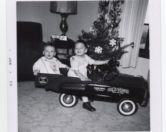 kids in toy pedal car vintage photo january 1956 paper ephemera holiday photograph christmas mid century
