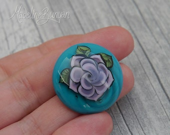 Tattoo Rose, lilac on turquoise Lampwork cabochon