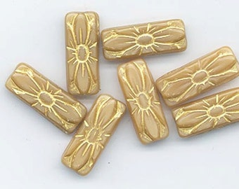 Five Czech pressed glass beads - golden beige with embossed design - 20 x 8 mm