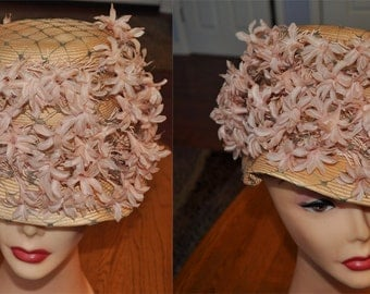 Vtg Saks Fifth Avenue straw sculpted hat with silk flowers and green netting. Great for weddings