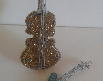 MUSICAL INSTRUMENTS BEADED-Beautifully hand crafted in Africa- Cello and Guitar- Ideal for the music lovers. Gorgeous decor pieces