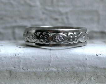 Sweet Floral Vintage Platinum Diamond Eternity Wedding Band.