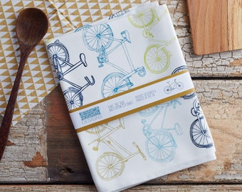 Take the Bike tea towel. Stylish cotton textiles for the kitchen. Kitchen dishcloth. Designed by Jessica Hogarth & printed in the UK.