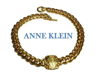 Anne Klein lion necklace, 1980s gold signature lion logo choker with chain link collar, signed with lion hang tag, toggle clasp