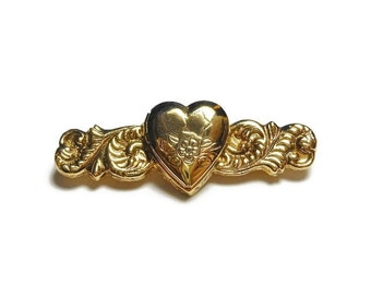 1928 heart locket brooch, gold heart locket bar bin with a star and flowers etched on the front