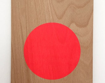 circle screenprint on plywood, neon red/pink